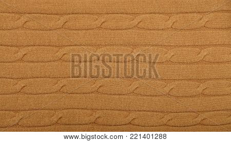 Close up background of pastel brown beige knitted wool jersey fabric texture