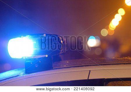 Blue police light in night action on crime scene