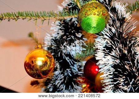 Christmas tree ornament. Glass globe in winter time for fir