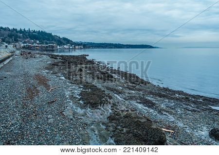 A view of the West Seattle shoreline on an overcast day.