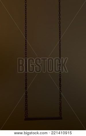 old swing sillhouette on dark background composition photography