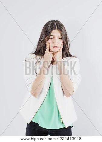 The brunette girl in Sorrow. White background.