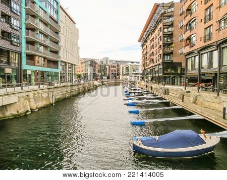 Channels of the Aker Brygge area. Aker Brygge, popular area with a lot of bars, restaurants, museums and viewing zone to scenic Oslo Fjord. Landmark of Oslo, Norway capital
