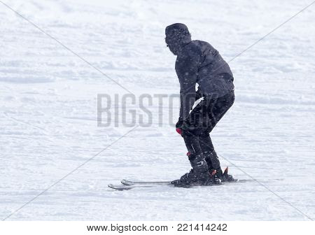 Athlete skiing in the snowy mountains . In the park in nature