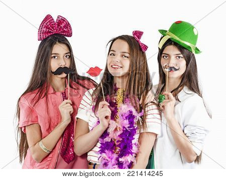 Young women wearing fake mustaches and lips. Ready for the party.