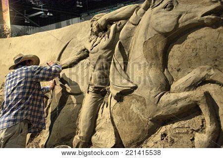 Artist working on a Sand Sculpture, Calgary, Stampede, Calgary, Alberta, July 11, 2011