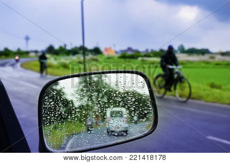CAR Mirror Window glass ON THE GO -TRAVELLING with condensation of natural water drops.. Abstract photo. In the month of August.Travel,Nature,water drop background.