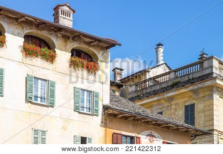 Orta San Giulio, Italy - August 18, 2013:  The traditional archirectures of Motta square