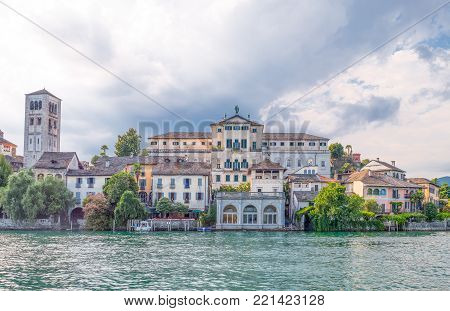 Orta San Giulio, Italy - August 18, 2013:  San Giulio Island, the Bishop's Palace and the Basilica