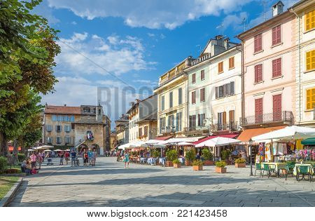 Orta San Giulio, Italy - August 18, 2013:  People and stores in Motta square