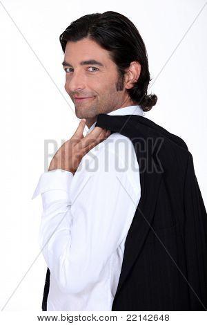 Roguish gent holding his jacket over his shoulder