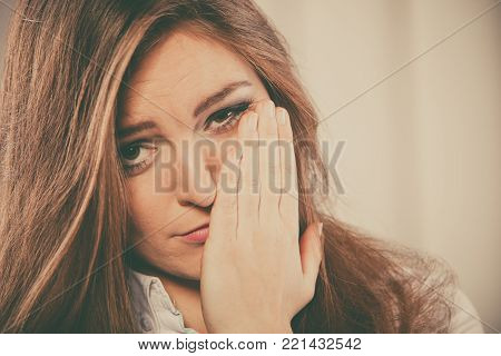 Negative emotions expression and sadness. Stressed young woman worry cover face cry alone.