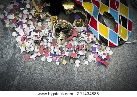 Carnival mask on colorful confetti and streamer background