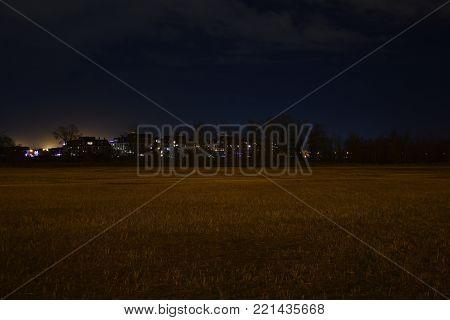 Neighbourhood  lights at night near a field