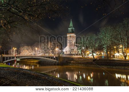 View Of The Turku Cathedral And Aura River By Night.