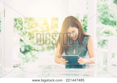 Asian Woman Looking Tablet Have A Angry And Upset Outside In The Park - Expression And Stress Of Com