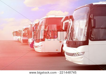 big tourist buses on parking toned photo
