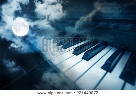 piano keys in moonlight cloudy night  photo
