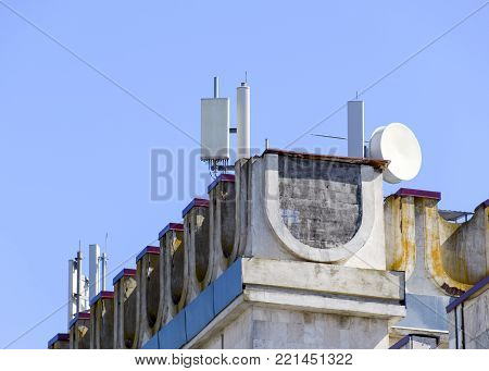 Cellular equipment on the roof of the building. Reflectors about signal repeaters