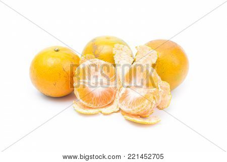 Ripe tangerine orange isolated on white background. Shogun orange fruit