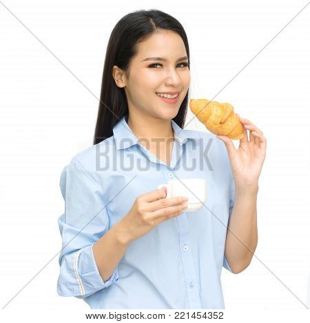 Asian woman holding in female hands croissant and drink hot aroma coffee or tea in breakfast time isolated on white background.