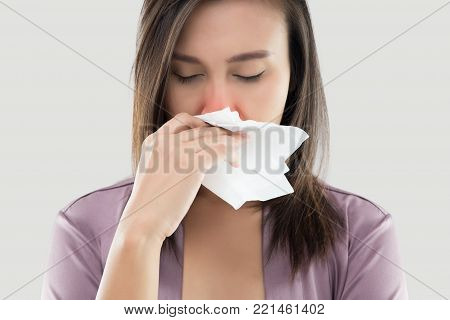 Asian Women In Satin Nightwear Feeling Unwell And Sneeze Against White Background, Dust Allergies, Flu, People Caught Cold And Allergy