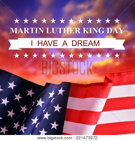 Martin Luther King Day. Flag of United States of America at sunset.