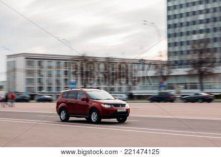 Gomel, Belarus - 21 April, 2017: Mitsubishi car of red color on a city road in motion
