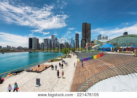 Navy Pier and Chicago skyline on June 21, 2017 in Chicago, Illinois. It was built in 1916 as 3300 foot pier for tour and excursion boats and tourist attraction.