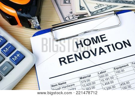 Clipboard with budget calculations about home renovation.
