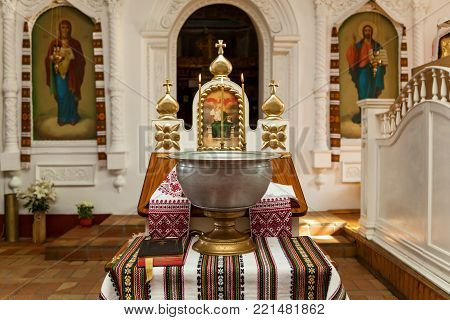 Accessories for the christening of children icons of candles and font, Orthodox Church. The Sacrament of Children's Baptism in the Church