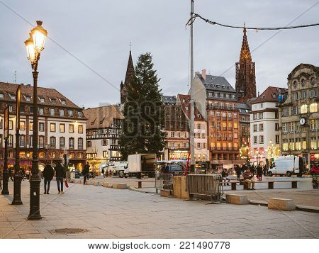 STRASBOURG, FRANCE - JAN 11, 2018: Busy Place General Kleber central square in Strasbourg at dusk with pedestrians walking and admiring the tallest Christmas Tree in Europe