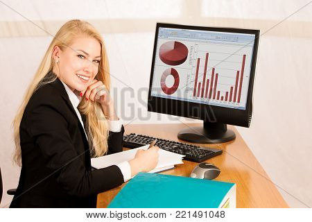 Young Accountant Woman Works At Her Desk In The Office