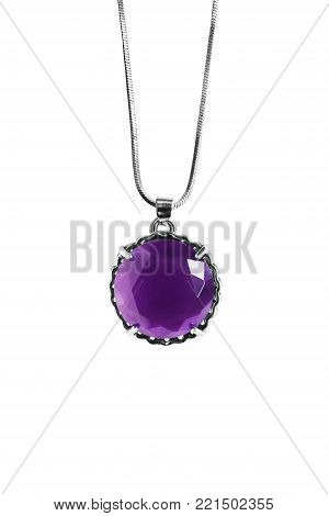Amethyst faceted pendant hanging on silver chain isolated over white