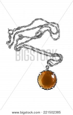 Elegant amber faceted pendant with a chain on white background