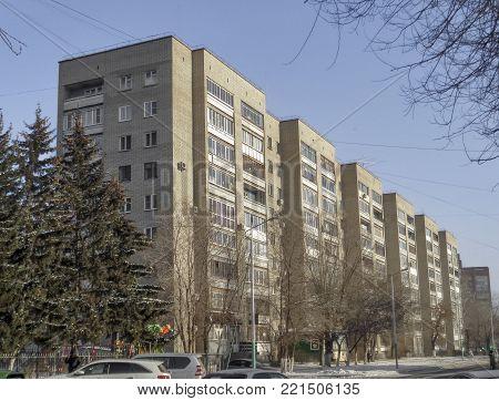 Old large apartment building. Apartment block. Housing estate.