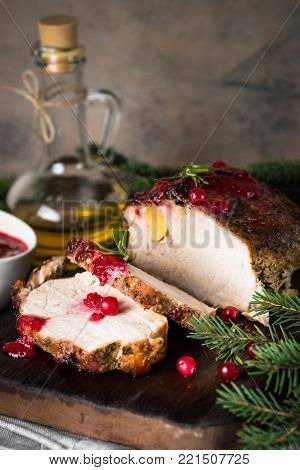 Christmas food. Pork meat ham baked with cranberry sauce. Close up.