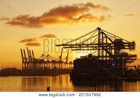 BIRZEBUGGA, MALTA - jan 9: cargo port in Birzebugga, Malta, panoramic view of cargo port early dramatic sunrise morning on jan 9, 2016, industrial area in Birzebugga, Malta. Business. Logistics