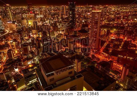 Aerial view of Osaka City Central Business downtown at twilight. Osaka Skyline from Kita ward of Japan. Osaka is Japan's third largest city by population after Tokyo and Yokohama.