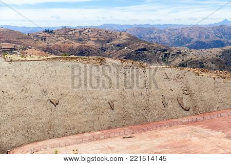 Real dinosaur footprint imprinted in the rock. Side view. Nacional Park in Sucre, Bolivia. Stock photo