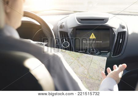 Person Driving A Car With Gps Navigation