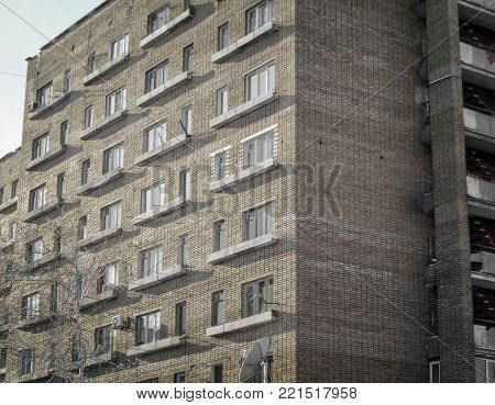 Old apartment building closeup. Old hostel. Old architecture. Urban landscape