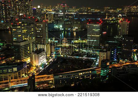 Aerial view over Tokyo cityscape, the Bay area with its bridges and Odaiba by night from Tokyo World Trade Center, Tokyo, Japan. Closeup of Tokyo cityscape.