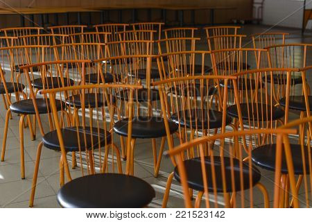 orange iron chairs, pattern of chairs, leather chair.