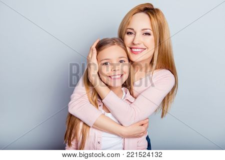 Cute, Pretty, Playful Mother And Daughter With Open Mouth Jumping In The Air Over Gray Background, C