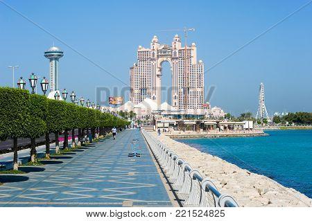 ABU DHABI, UNITED ARAB EMIRATES - DEC 30, 2017: Corniche boulevard along the coastline in Abu Dhabi.