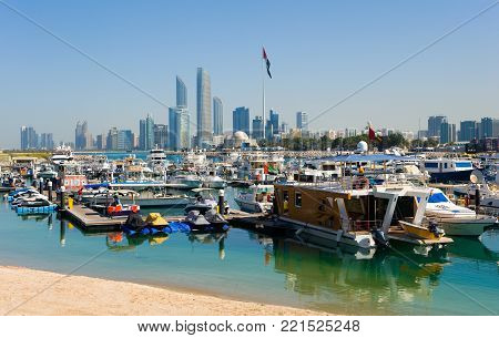 ABU DHABI, UNITED ARAB EMIRATES - DEC 30, 2017: Skyline of Abu Dhabi with boats in front of Abu Dhabi.