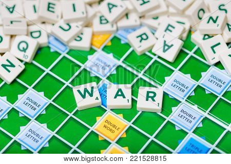 London, England, November 16, 2017 - Scrabble letters spelling the word war