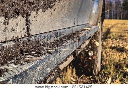 Dirty side and thresholds of the car.