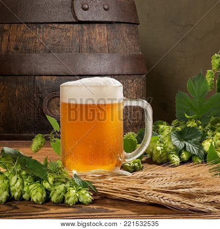 Beer Glass and Hop Cones with Wheat